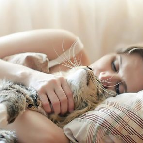 Why Do Cats Sleep on Me? | Reader's Digest