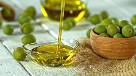 Olives and Pouring Olive Oil. 库存影片视频(100% 免版税)9529409   Shutterstock