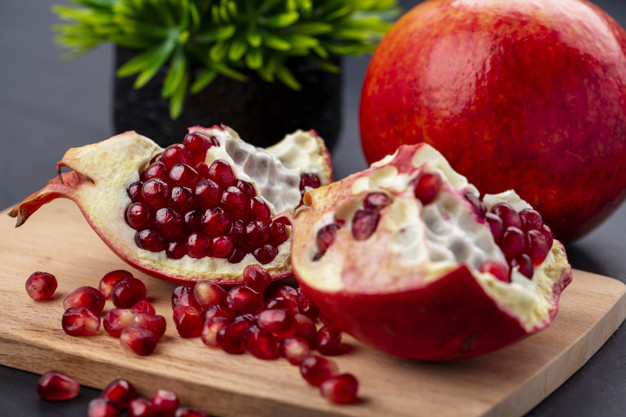 https://www.freepik.com/free-photo/close-up-view-pomegranate-pieces-berries-cutting-board-with-whole-one-black-surface_9478506.htm#page=2&query=Pomegranate&position=39