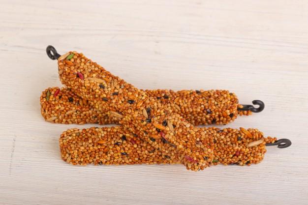 https://www.freepik.com/premium-photo/parrot-seed-nutrient-sticks_12422408.htm#page=1&query=Birdseed%20&position=4