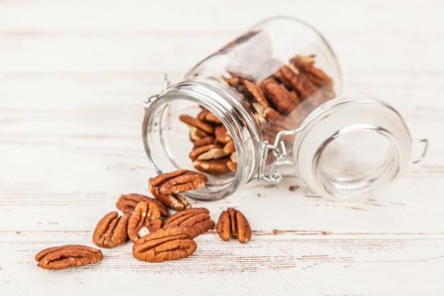 https://www.freepik.com/premium-photo/pecan-nuts-closeup_5179877.htm#page=2&query=pecans&position=18