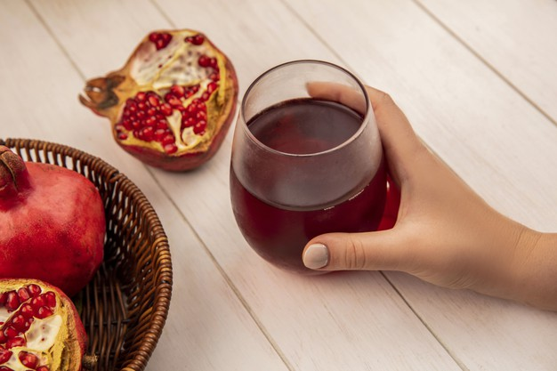 https://www.freepik.com/free-photo/side-view-woman-holding-glass-pomegranate-juice-with-pomegranates-basket-white-wall_13770460.htm#page=1&query=Pomegranate&position=47